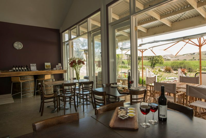 A view of our cellar door looking out toward the vineyard in the background