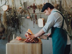 Butcher Troy Wheeler cutting meat to customer requirement at the central wood block station