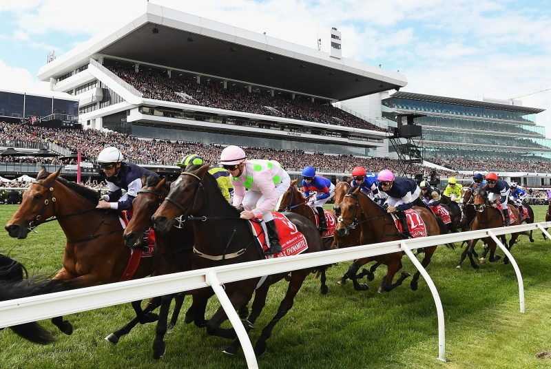 Horses racing during Melbourne Cup Carnival