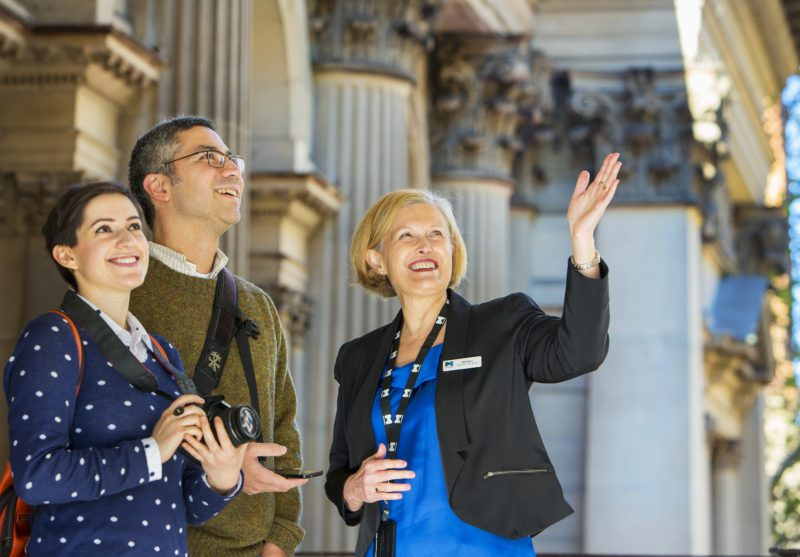 A Town Hall tour guide showing visitors the beautiful Portico