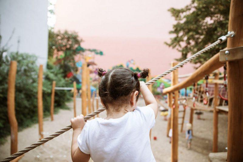 child playing in modern playground