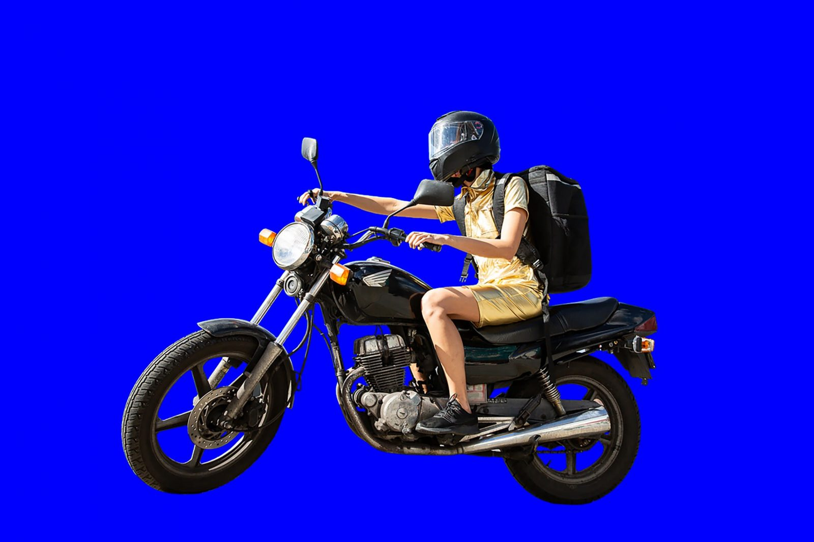 person riding motorbike in a gold dress wearing a food delivery backpack