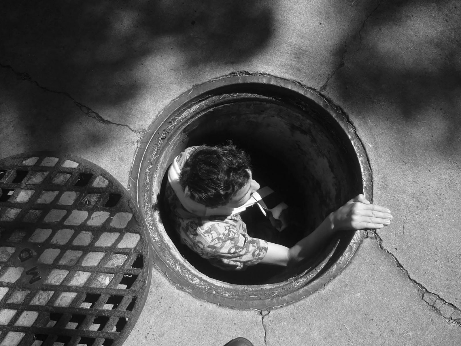 Person emerging out of a drain