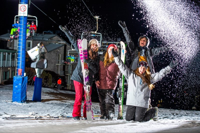 Smiling faces during twilight skiing