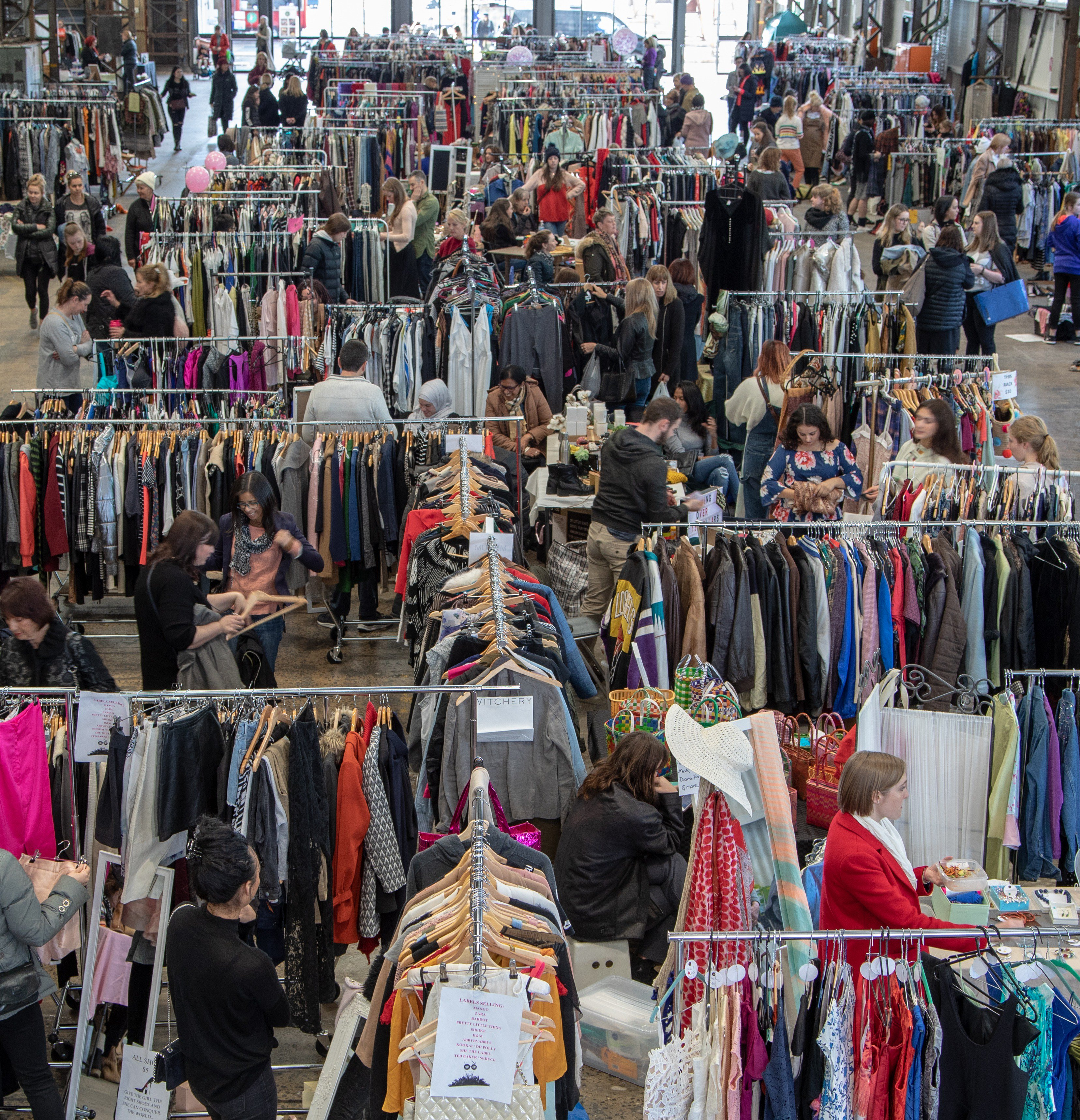 Indoor market of more than 60 stalls selling women's pre-loved fashion and accessories.