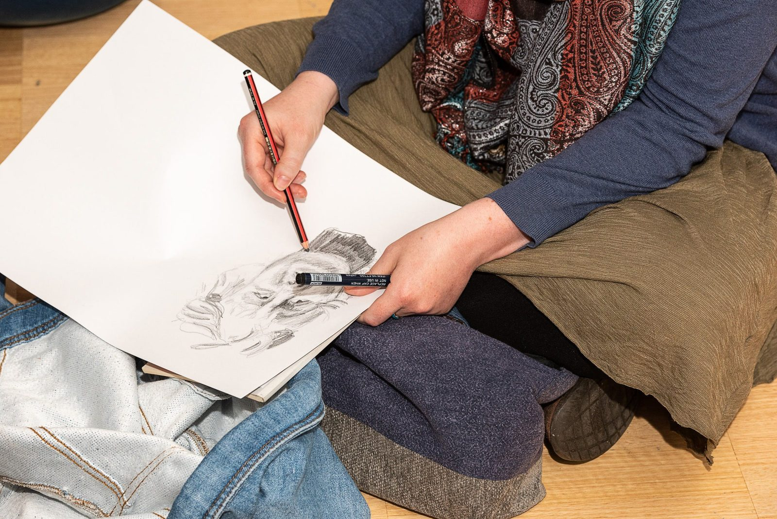 A person sketching.