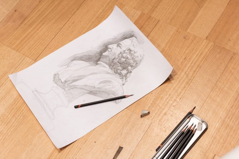 A sketched figure on paper.