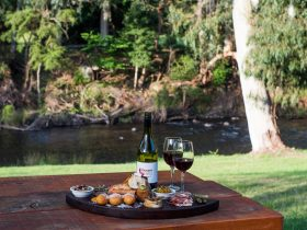 Wine and Meze Board on the Picnic Table by the River