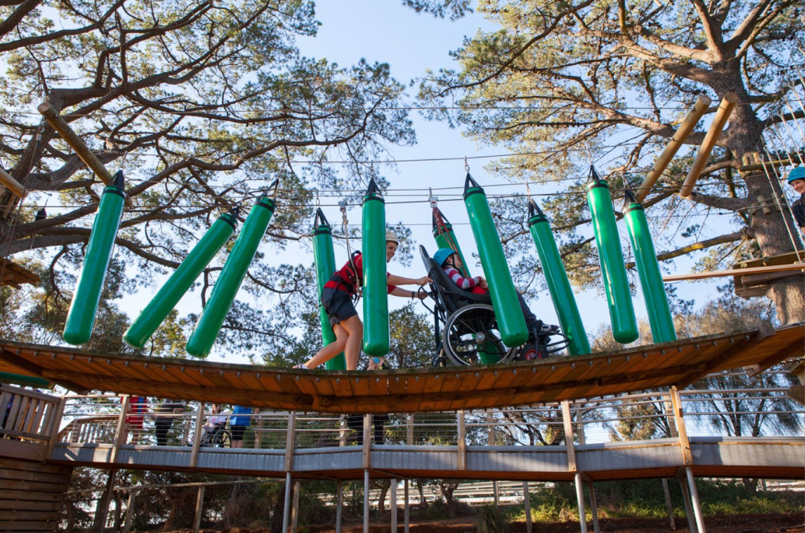 Image: person in wheelchair enjoing accessible high ropes course