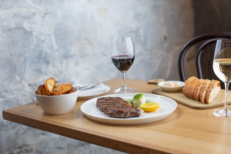 Wagyu steak with handcut ships and a glass of shiraz