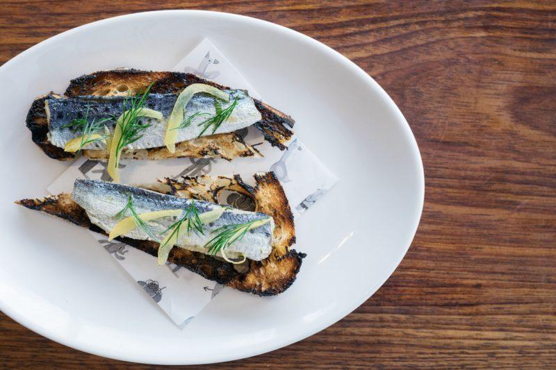 Sardines, toast and preserved lemon