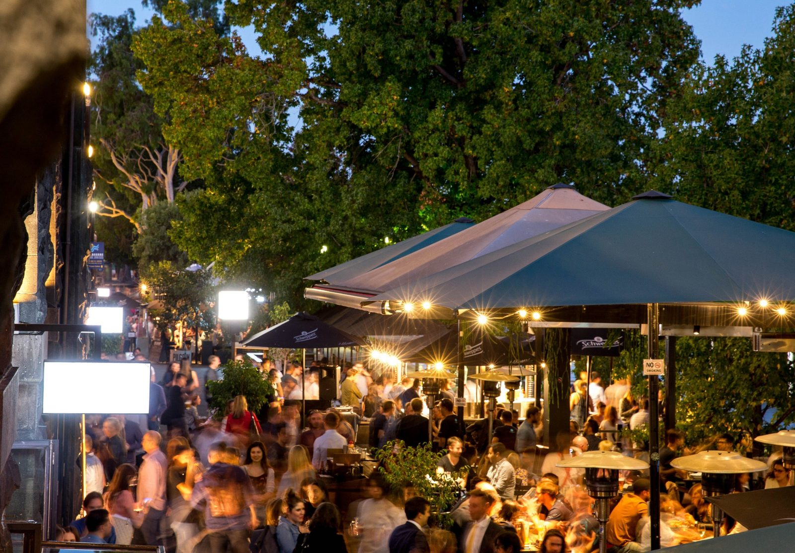 A crowd of people at Riverland Bar at night