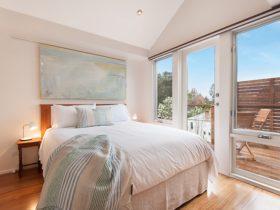 Bedroom opening onto elevated deck. Highest quality Sleepmaker Queen size bed