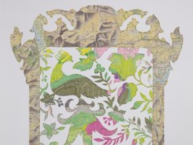 Detail of artwork made from hand cut maps, and pink and green chintz