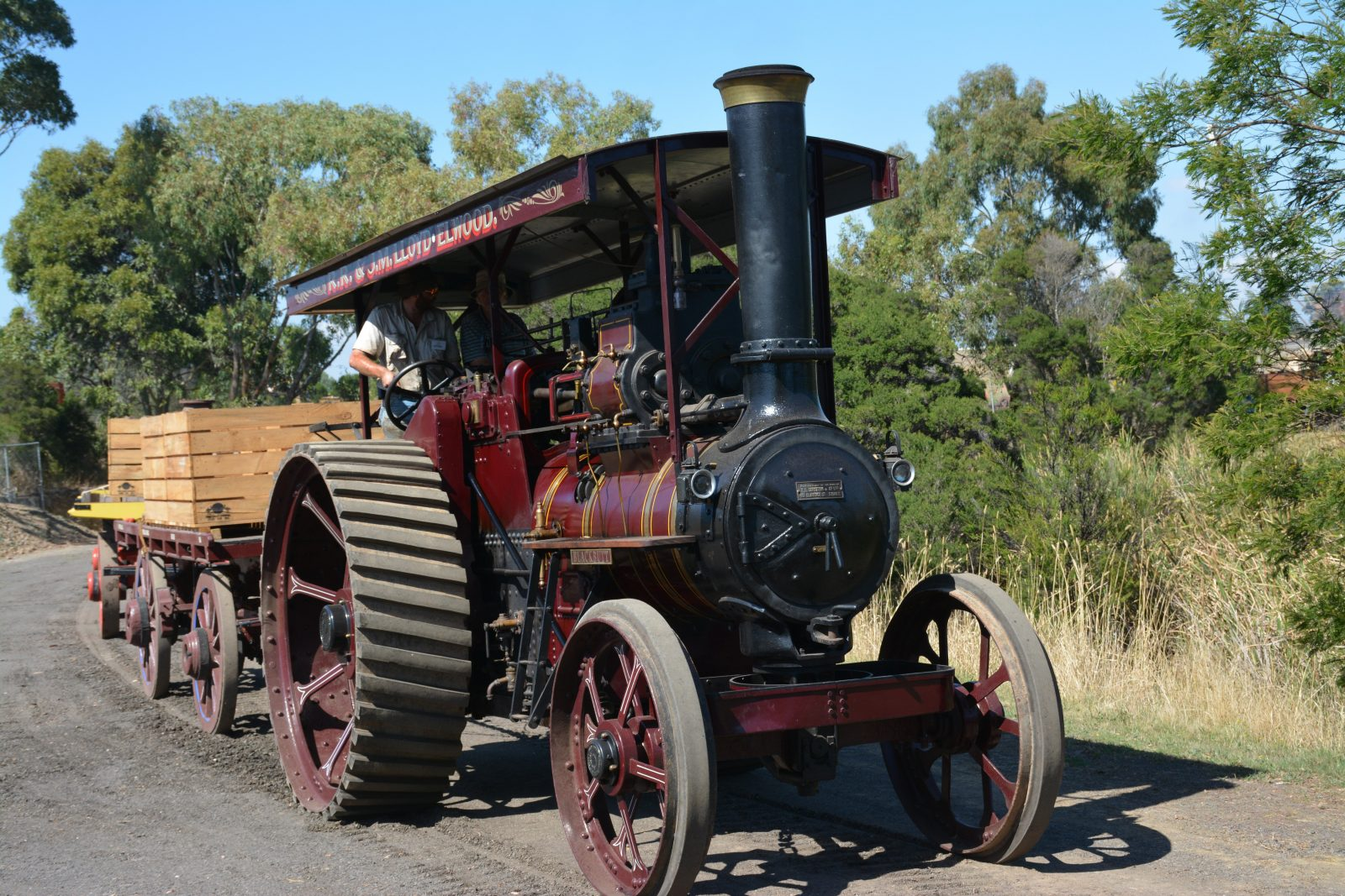 A steam traction engine towing an old wagon