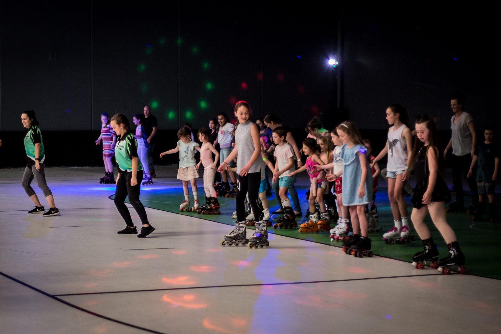 Kids having fun roller skating at Sk8house