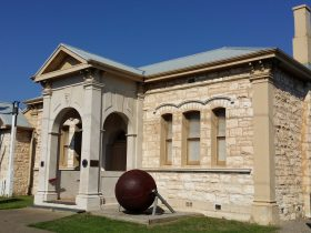 Sorrento Museum, a limestone building with a steel ball outside to the right of the door