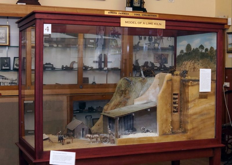 Model shows limeburning kiln with horse and cart and men working