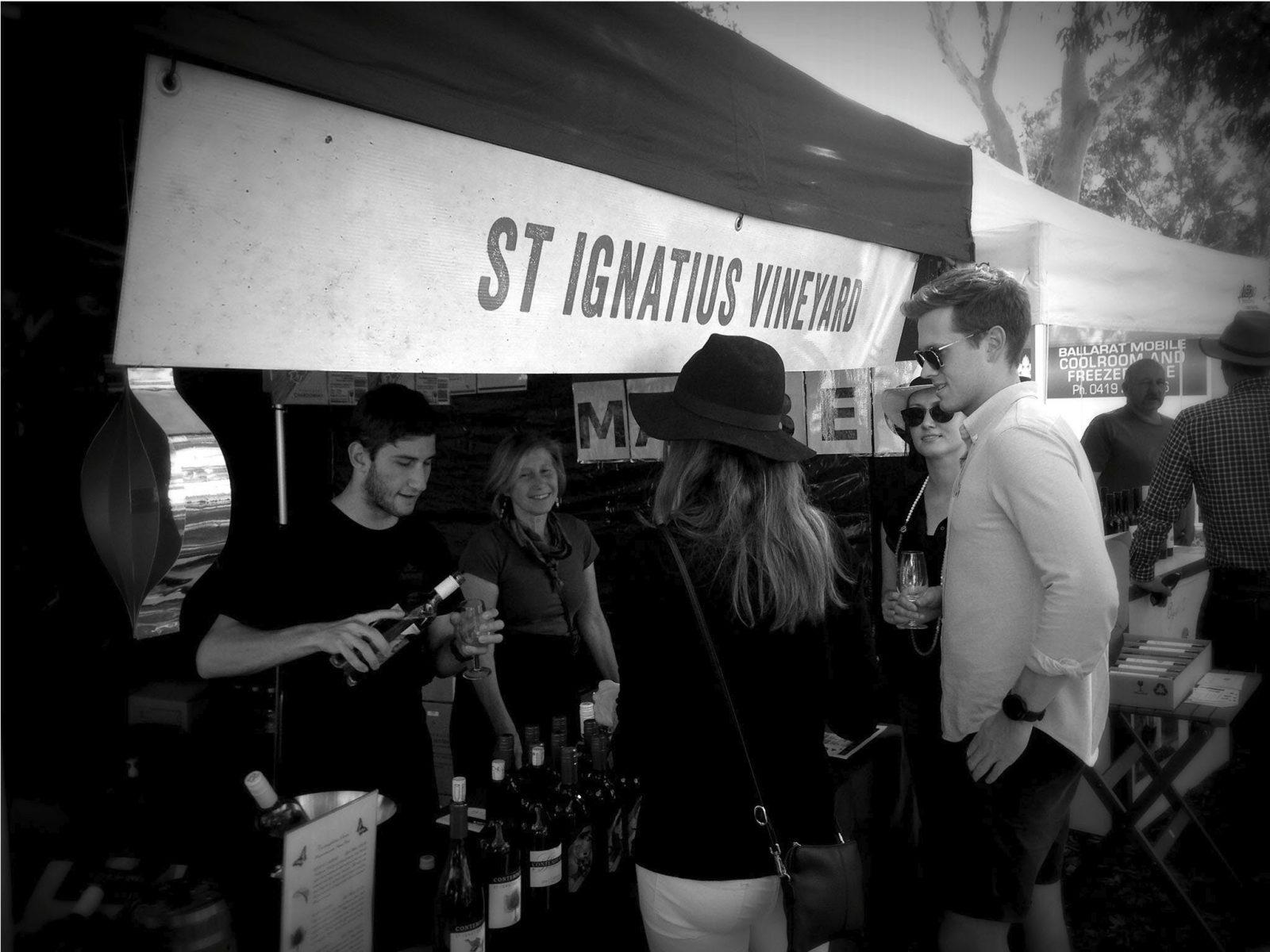 St Ignatius Team offering wine tastings to customers