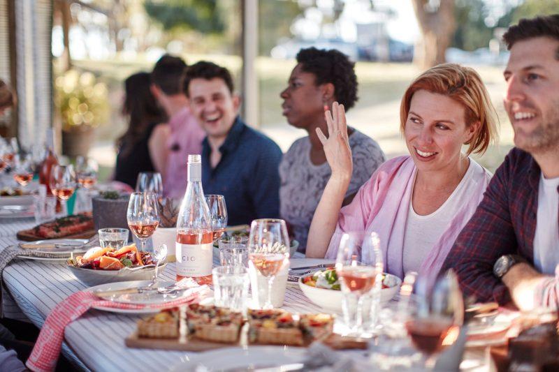 Festival goers enjoying food and wine