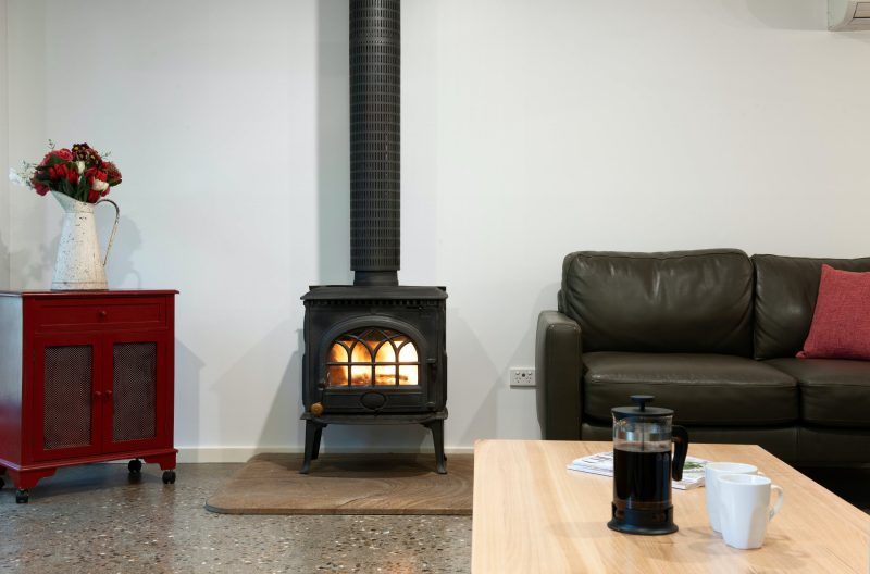 Fire with logs provided. Plus double glazing, & aircon & 5 blanket doonas. You will be toasty warm