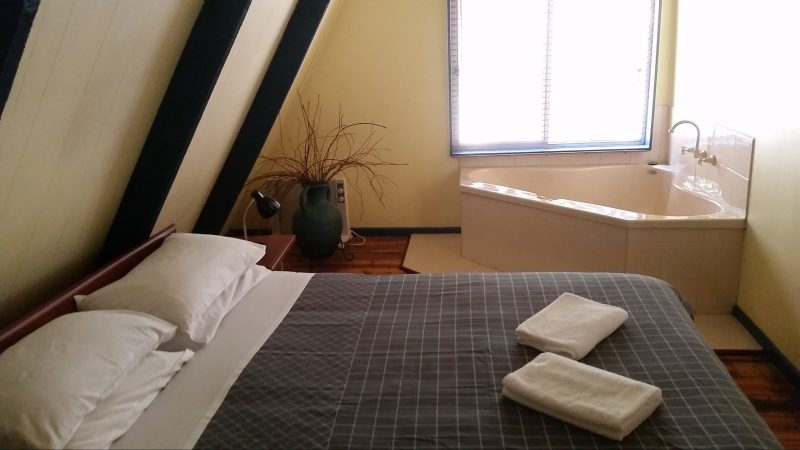 The main bedroom with queen bed and spa