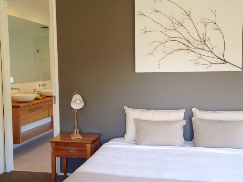 King size bed and its modern bathroom