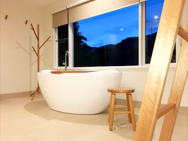 View from king Bedroom showing Deep Hydrotherapy Spa Bath and its bespoke timber fittings .