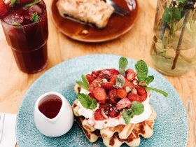 Lime Time - Belgian waffles with lime macerated strawberries, whipped yoghurt and toasted pistachio.