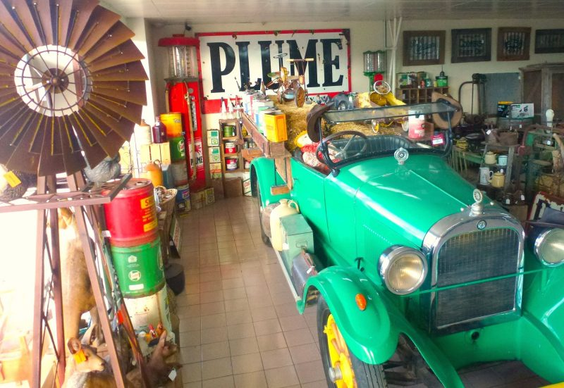 vintage Dodge and enamel Plume sign with Windmill in shopfront