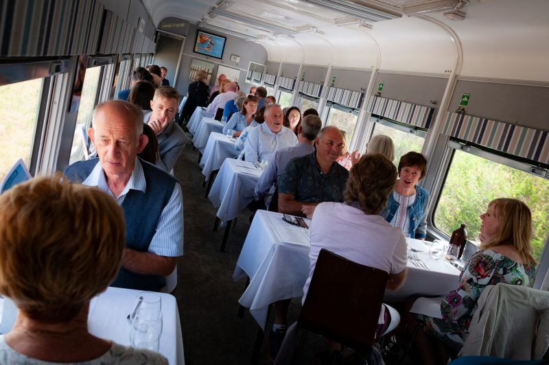 Inside dining carriage full of customers