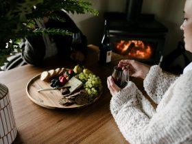 Enjoying a fireside wine and cheese board