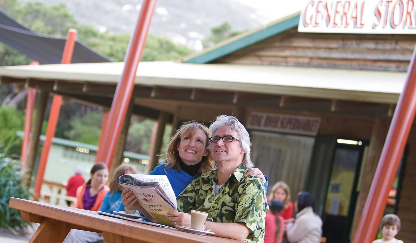 Couple Enjoying a Coffee Outside the Tidal River General Store
