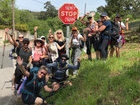 Women hiking Camino Portugal with sign