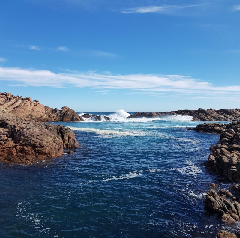 Canal Rocks is an iconic tourist site where surf rushes through a natural canal.