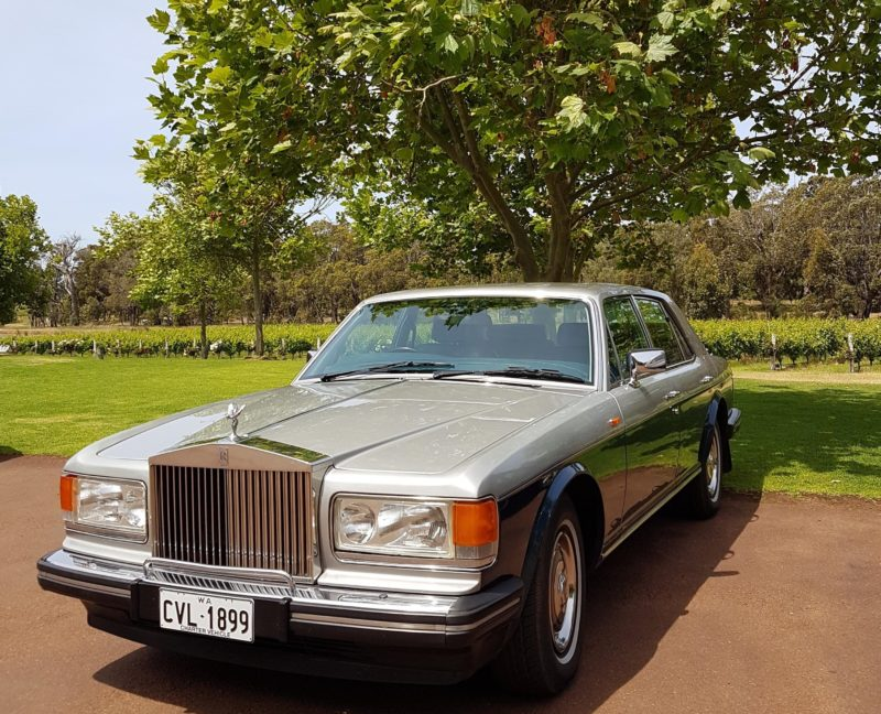 One of two Rolls Royce cars waiting for passengers at one of the local wineries