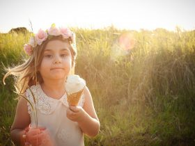 Girl In Paddock with Ice Cream cone