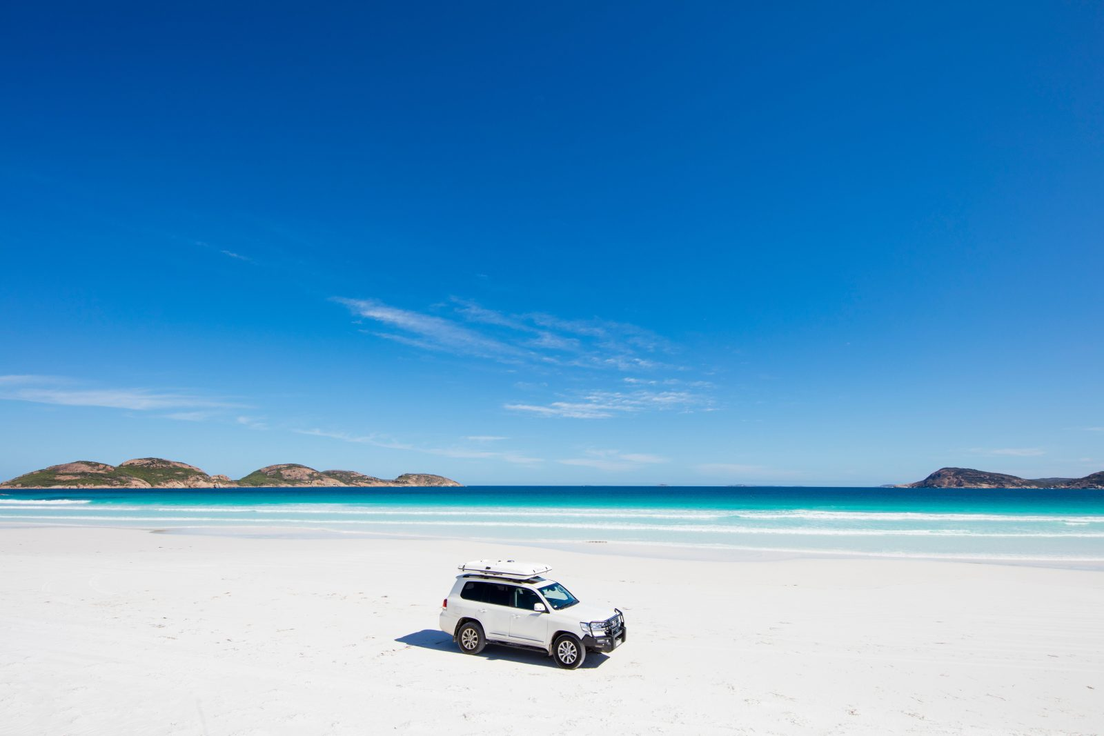 Four wheel driving along a beach in Esperance Western Australia